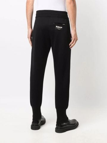Black tapered McQueen Graffiti logo-patch track pants
