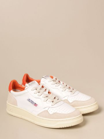 Low-top sneakers in white and orange leather and suede
