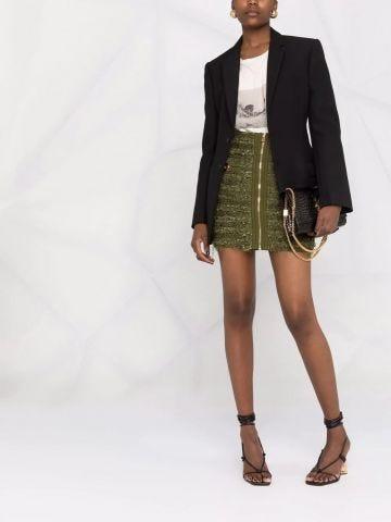 Short green tweed skirt