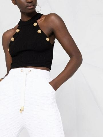 Black knit crop top with gold-tone buttons