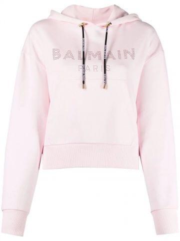 Felpa taglio corto in cotone rosa pallido con logo Balmain in strass