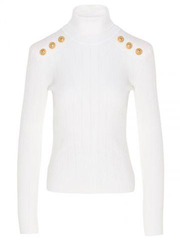 Maglione bianco in maglia con bottoni dorati