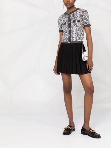 Cardigan taglio corto in maglia scintillante bianco e nero con monogramma Balmain