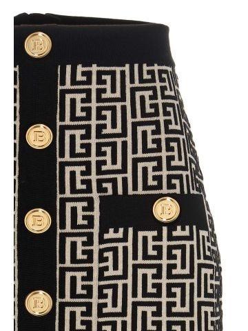 Short white and black wool skirt with Balmain monogram