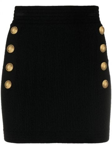 Short black knit high-waisted skirt with double-buttoned fastening