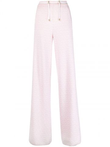 Pink and white palazzo pants with Balmain monogram