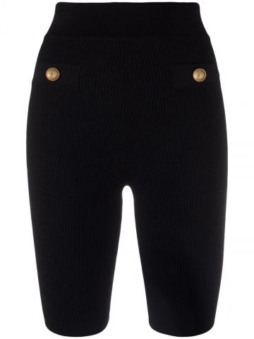 Black ribbed cycling-style shorts with gold-tone buttons