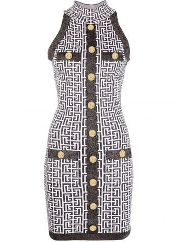 Black and white knit dress with gold-tone buttons