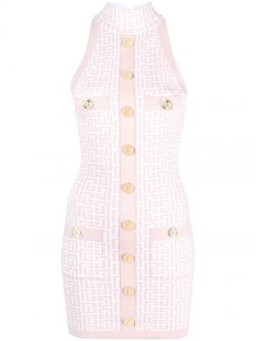 Pale pink and white knit dress with gold-tone buttons