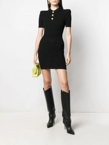 Short black knit dress with gold-tone buttons