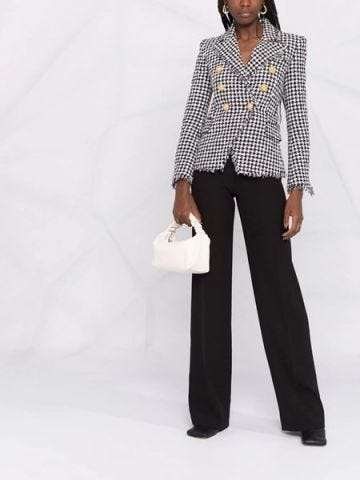 White and black houndstooth jacket