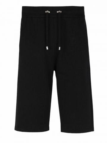Black cotton shorts with flocked blue Balmain Paris logo