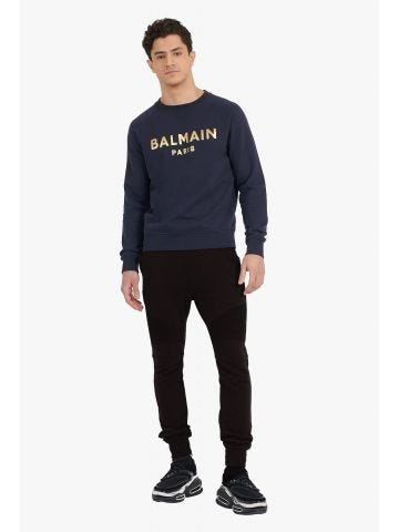 Black cotton sweatpants with gold Balmain Paris monogram print