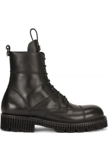 Boarded black calfskin boots with extra-light sole