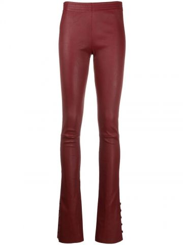 Red flared leather trousers