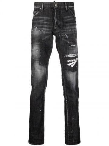 Black distressed logo patch jeans