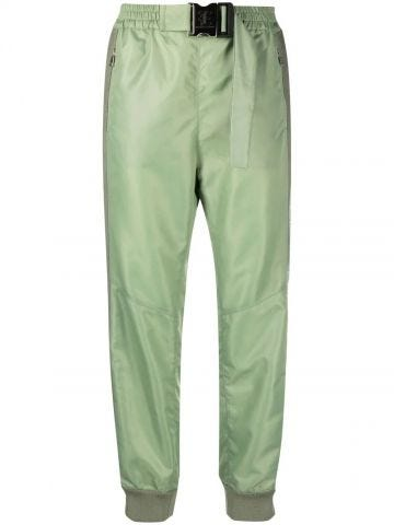 Pantaloni verdi con banda laterale e cintura