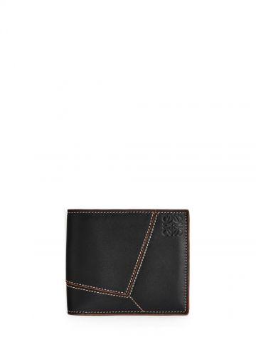 Puzzle stitches bifold wallet in smooth black calfskin