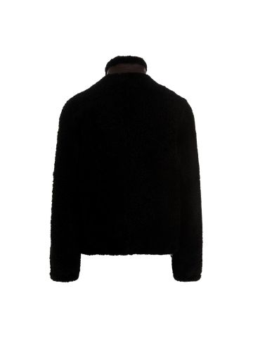 Giacca in montone nero con tasca pelle