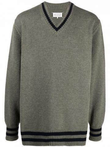 Green V-neck jumper