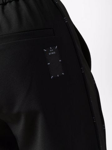 Black sports trousers with logo details