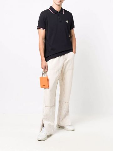 Navy blue polo with tricolor detail