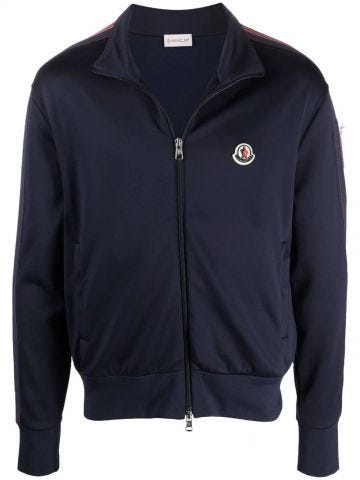 Blue track jacket with felt logo