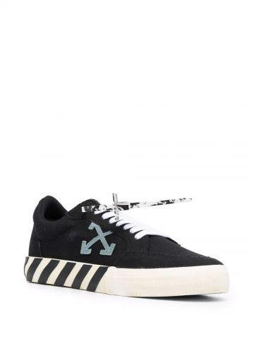 Black vulcanized low-top sneaker