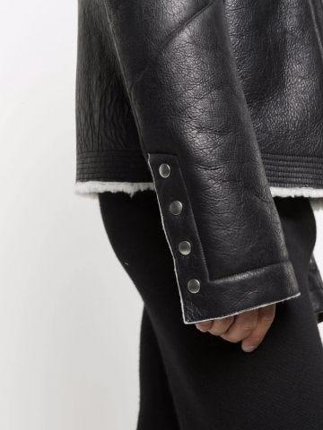 Giacca in pelle nera con pelliccia  in Shearling