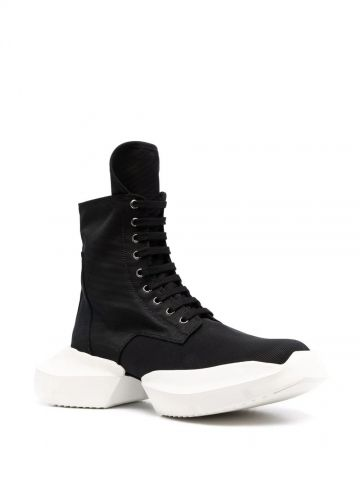 Black sneaker-style lace-up boots
