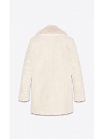 Cappotto doppiopetto bianco in velluto a coste con collo in pelliccia