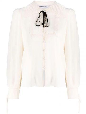 White bib-collar embroidered blouse