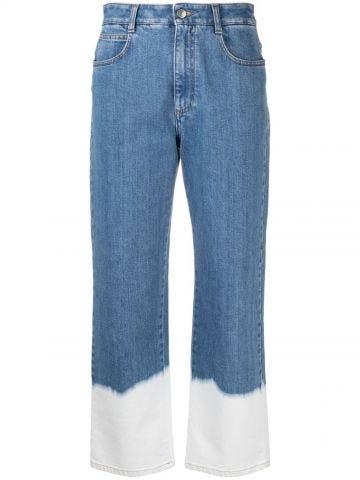 Dip faded hem washed blue jeans