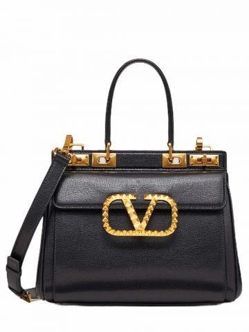 Large Rockstud Alcove handbag in black grainy calfskin