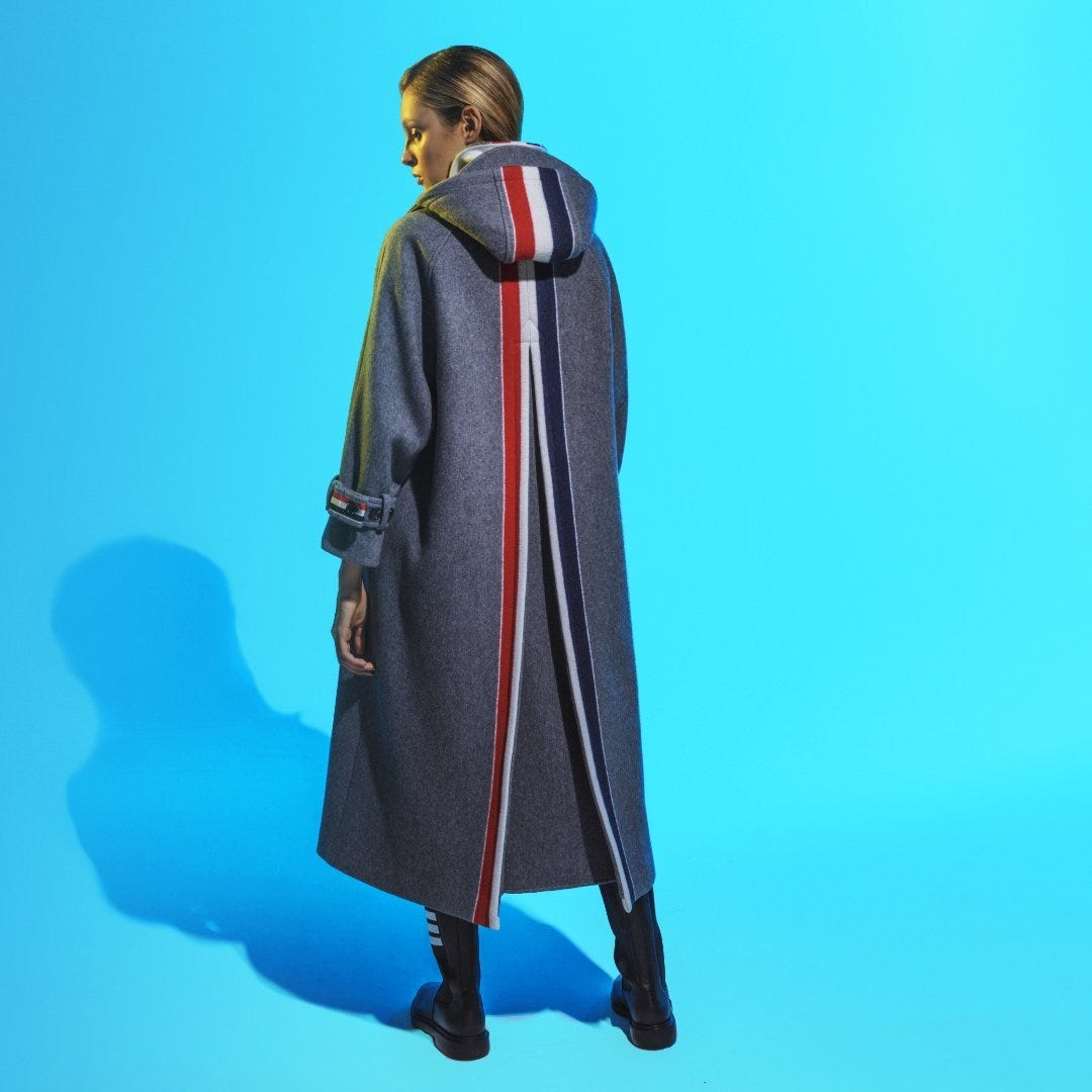 SIGNATURE STRIPES: @thombrowne prepares your wardrobe for cold weather with this RWB-stripe long duffle coat. Made of wool and cashmere, this coat is enhanced by a design with a recognizable note.  Available ongenteroma.comand in store at Via del Babuino, 77.  Photographer@ruben.quaranta@lipperide  Model –@fashionartwisemanagement MUA@martychio  #GenteRoma #ThomBrowne #FW21