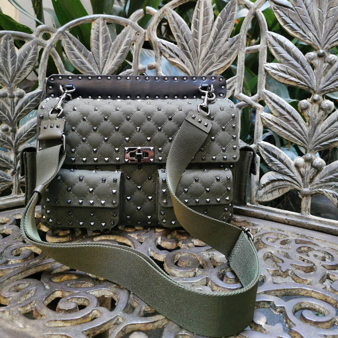 Quilted construction  @genteroma @maisonvalentino   Valentino Garavani Rockstud Spike canvas bag with pockets available in our boutique.  #GenteRoma #ValentinoGaravani  #FW20