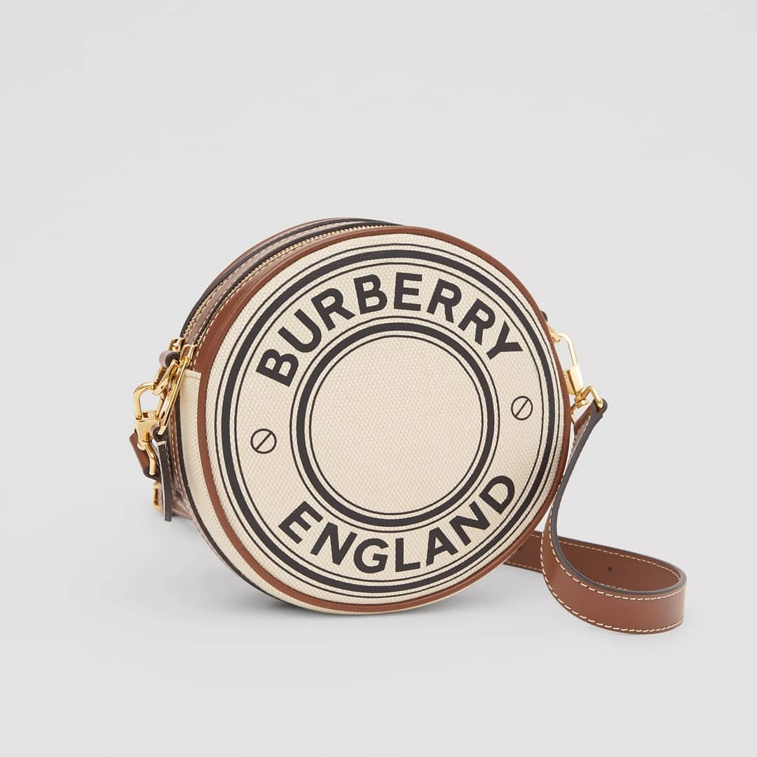 Mini round shape @genteroma @burberry   Burberry Logo graphic canvas and leather Louise bag available in store at Via Frattina, 93.  #GenteRoma #Burberry #SS21