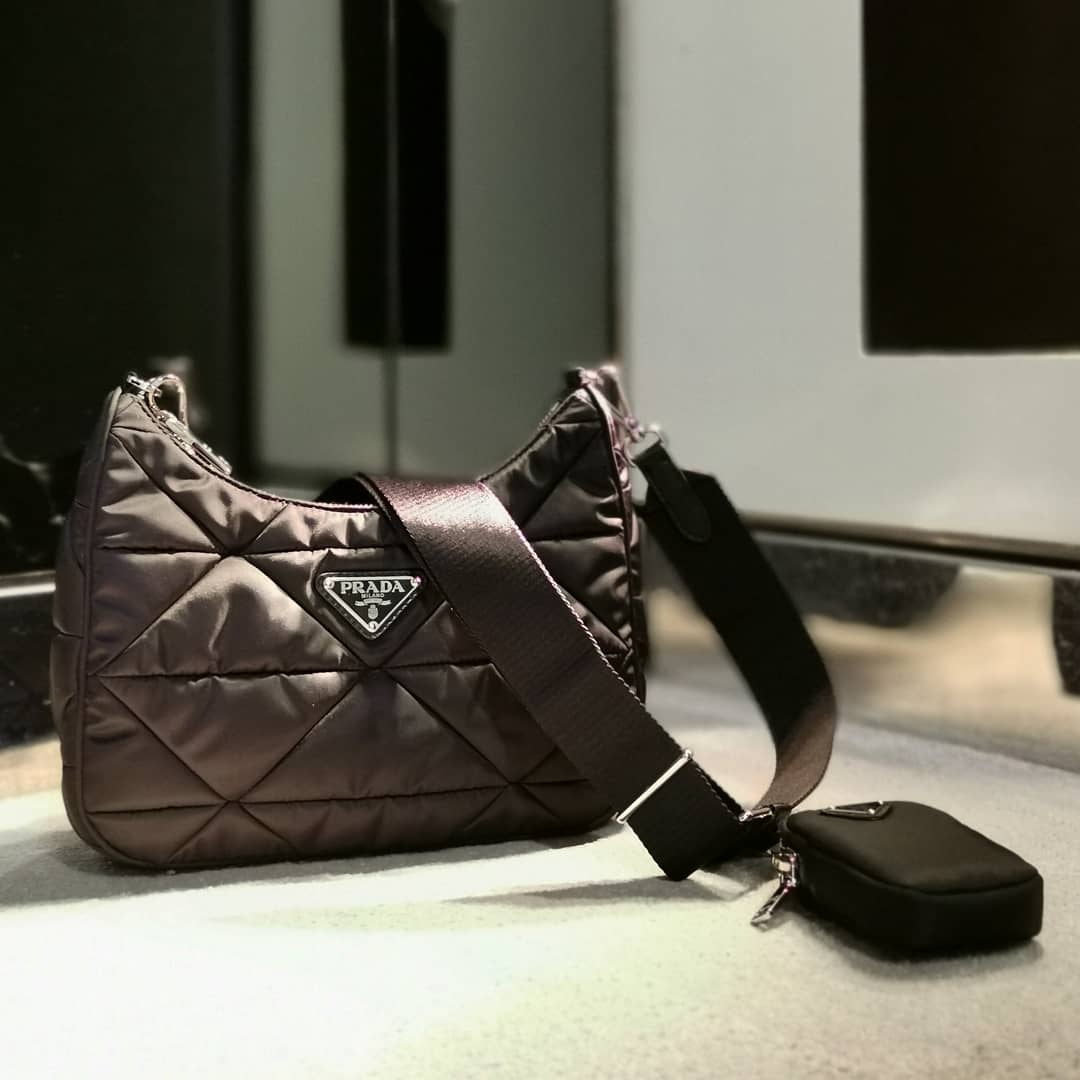 Padded nylon @genteroma @prada   Prada shoulder bag available in our boutiques.  #GenteRoma #Prada #SS21