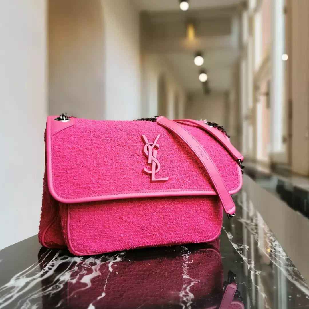 EYE-CATCHING PINK: the iconic@ysl Niki bag never looked better. Updated in a new version in magenta pink tweed, this bag is the perfect touch of colour to brighten up your look.  Available on genteroma.com and in store at Via del Babuino, 77.  #GenteRoma #SaintLaurent #FW21