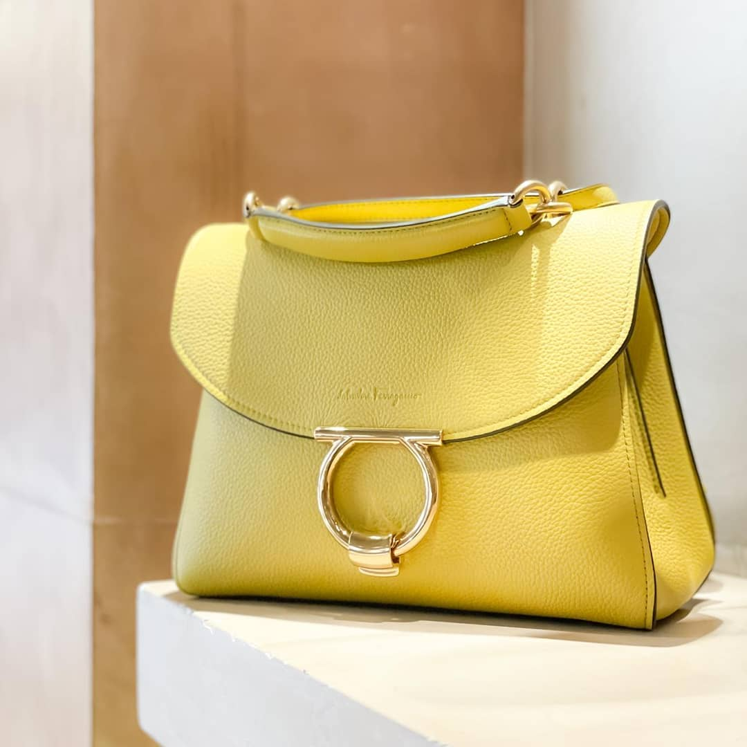 Elegant silhouette  @genteroma @ferragamo   Salvatore Ferragamo Gancini top handle bag available in our boutiques.  #GenteRoma #SalvatoreFerragamo #SS21