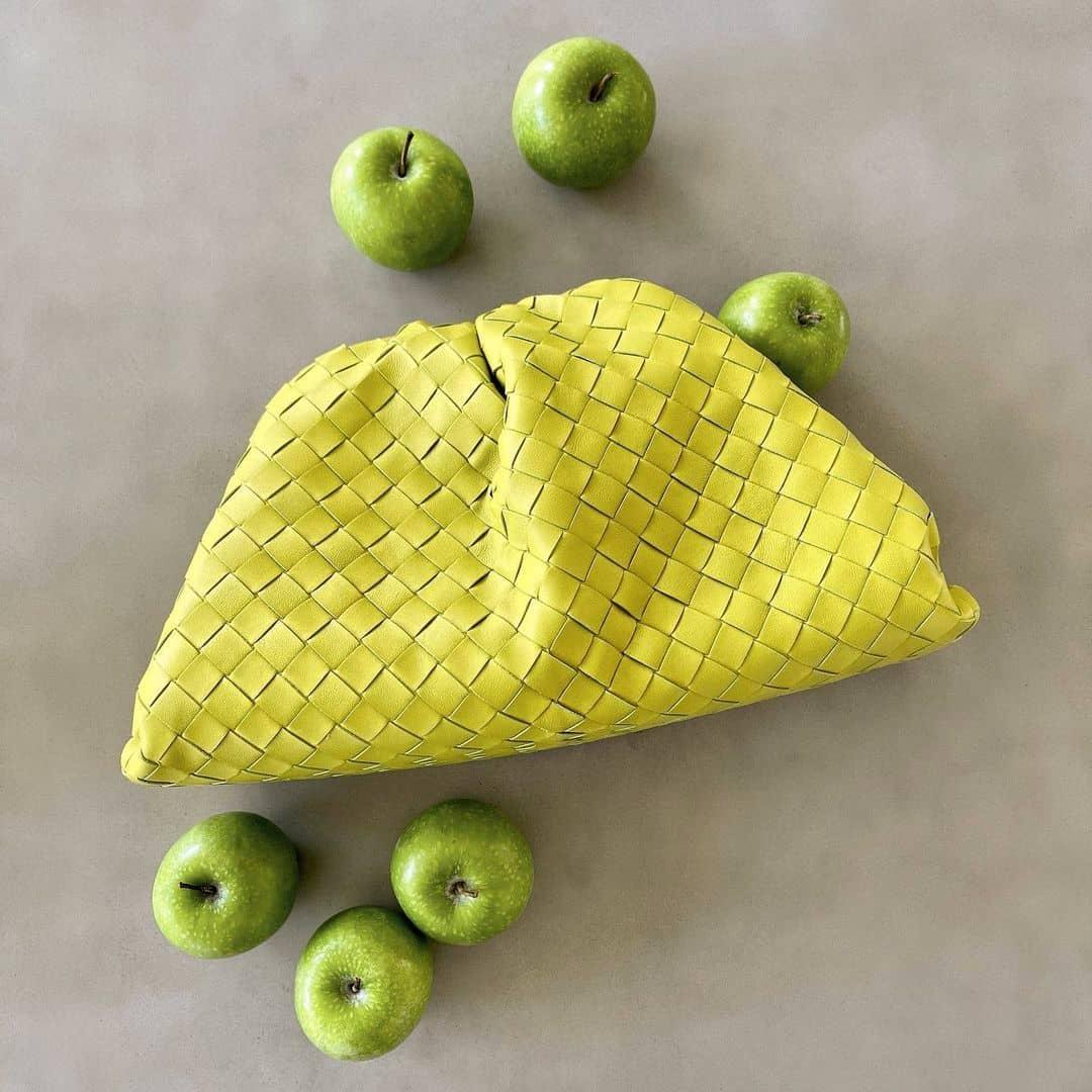 Summer color @genteroma #BottegaVeneta   Bottega Veneta Yellow Intrecciato Pouch available on genteroma.com and in store at Via del Babuino, 77.  #GenteRoma #BottegaVeneta #SS21