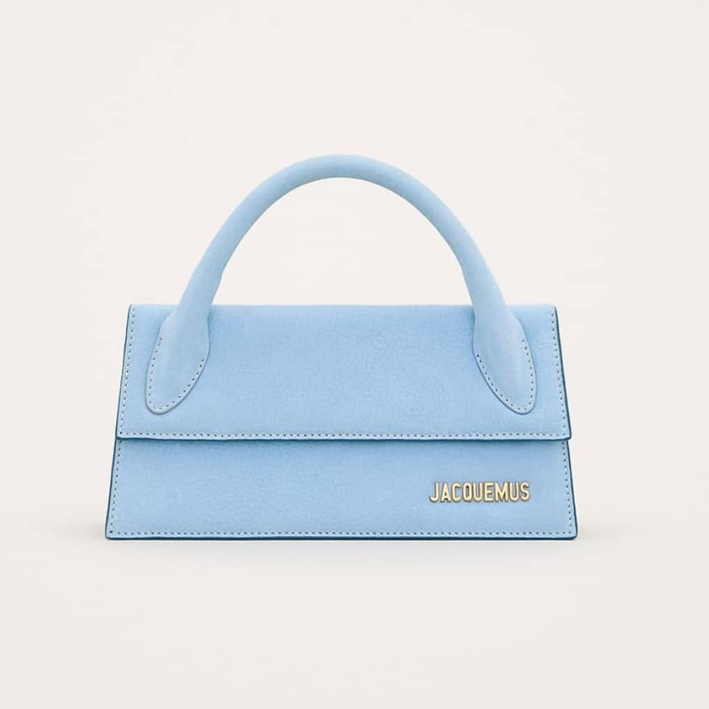 Light blue @genteroma @jacquemus   Jacquemus Le Chiquito Long bag available on genteroma.com and in our boutiques.  #GenteRoma #Jacquemus #FW20
