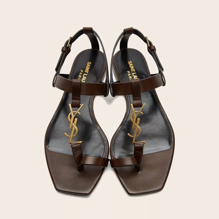 Gold-tone monogram  @genteroma @ysl   Saint Laurent Cassandra flat sandals available on genteroma.com and in our boutiques.  #GenteRoma #SaintLaurent #SS21